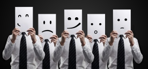 businessmen-holding-cards-with-different-emotional-faces-pop_12897
